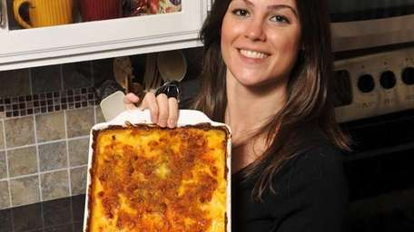Stephanie Johnston poses with the macaroni and cheese