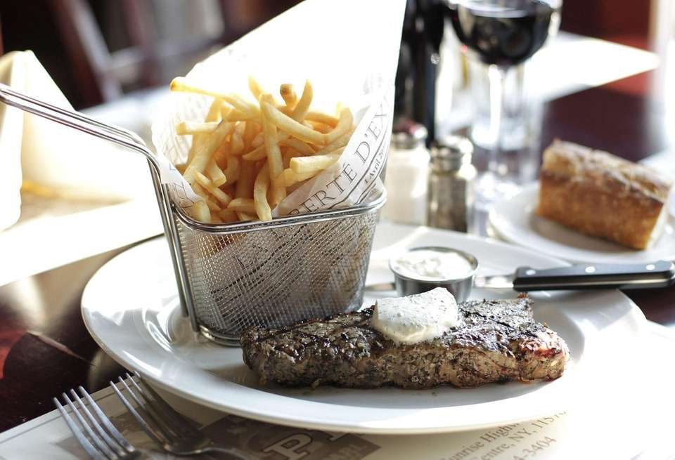 Steak frites is served at Aperitif Bistro Lounge