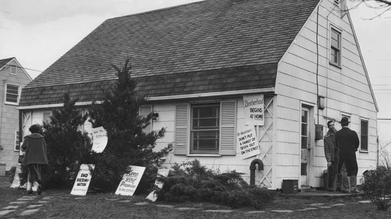 The Cotter house was plastered with signs in