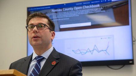 Nassau County Comptroller Jack Schnirman at a news