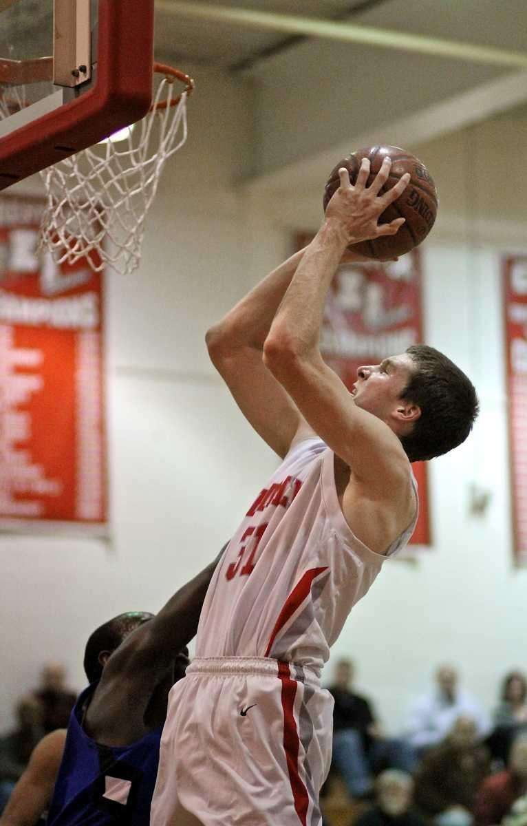 East Islip forward Evan Maxwell #31 puts in