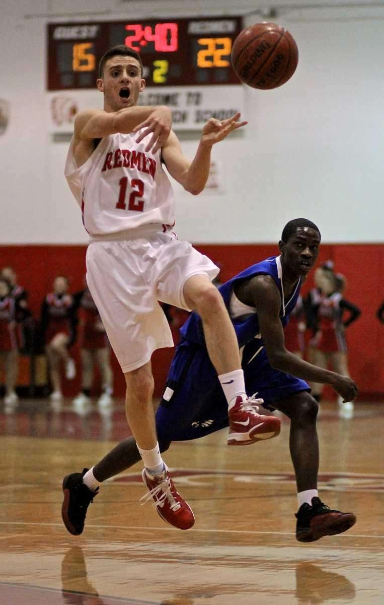 East Islip guard Brian Johnson #12 moves the