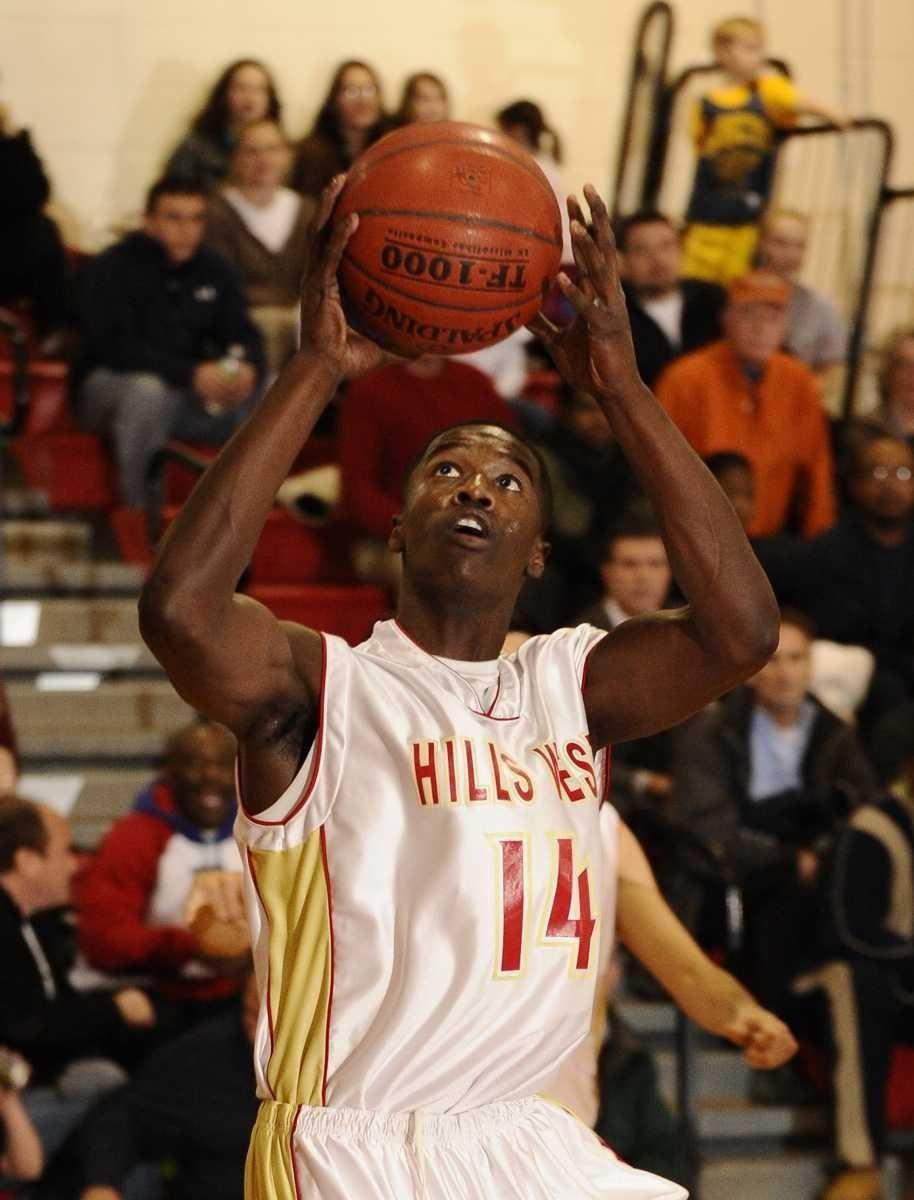 Half Hollow Hills West's Chris Cox shoots against