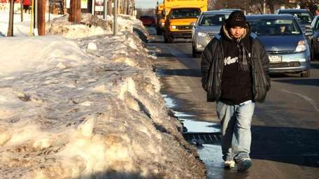 Some Long Island sidewalks are still covered with