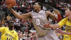 Ohio State's Jared Sullinger, center, goes up for