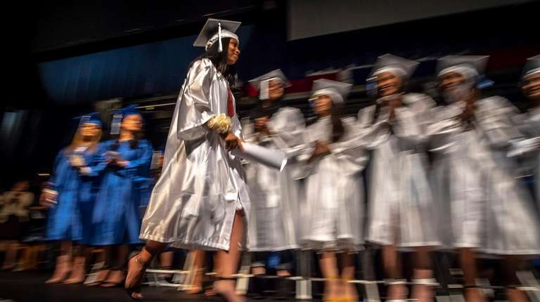 Hempstead High School valedictorian Stephanie Chevez heads back