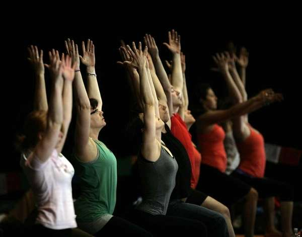 Yoga enthusiasts practice at an event in Melbourne,