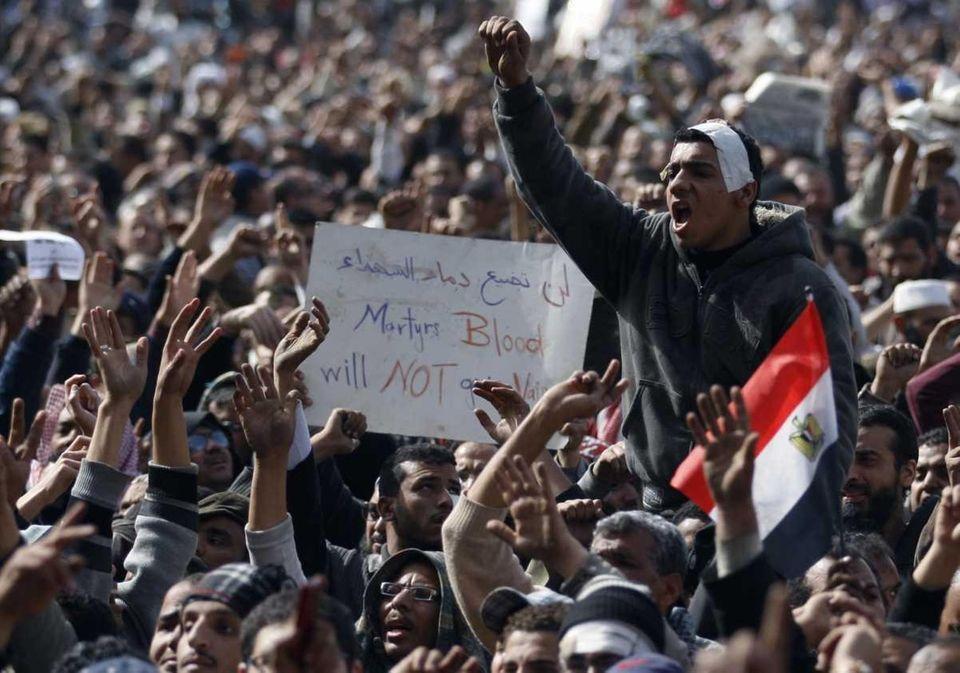 Anti-government protestors react in Cairo. (Feb. 4, 2011)