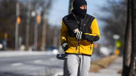 A man, bundled up for the cold weather,