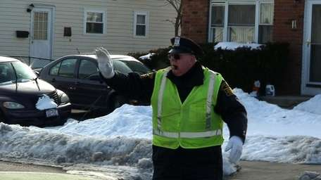 Walter Whitehead, 83, has been the crossing guard