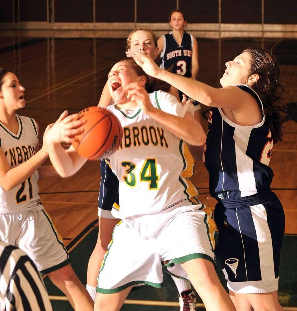 Lynbrook's #34 Jen Fay reacts as she battles