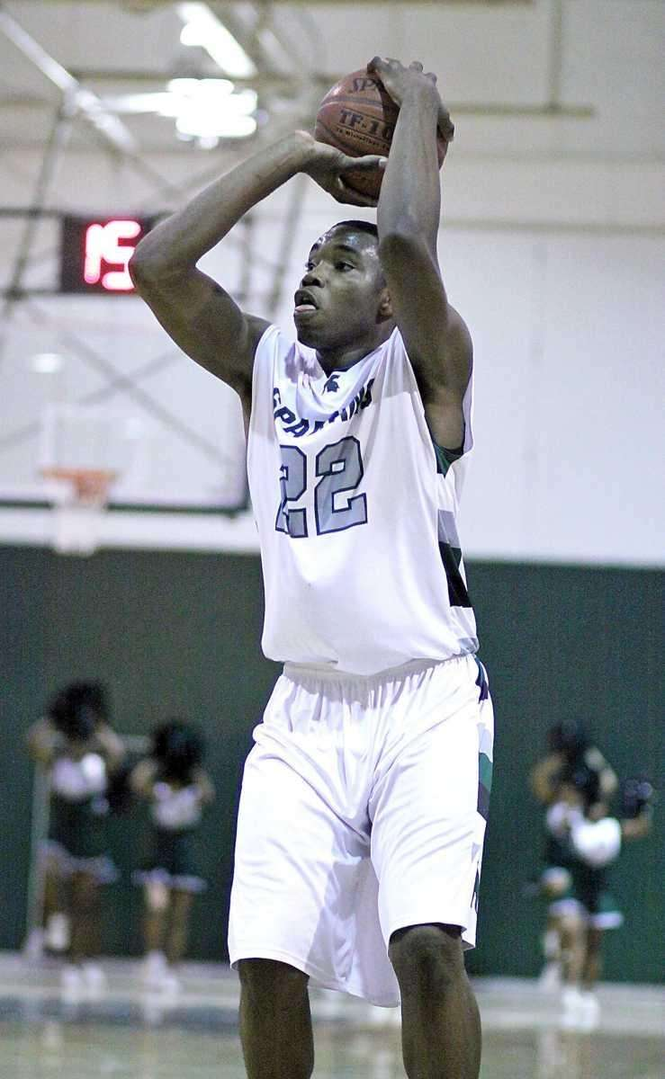 Elmont's Anthony Elechi hits from the outside. (Feb.
