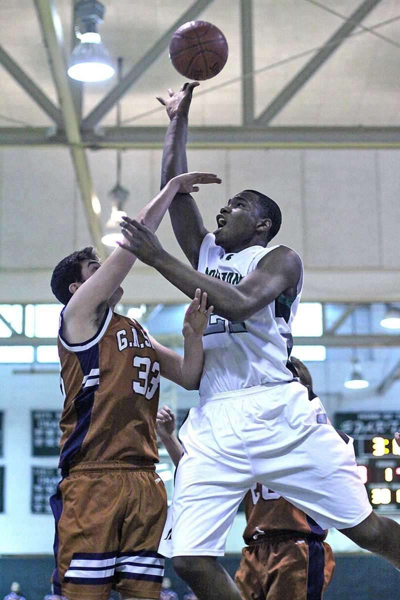 Elmont's Anthony Elechi shoots over Great Neck South's