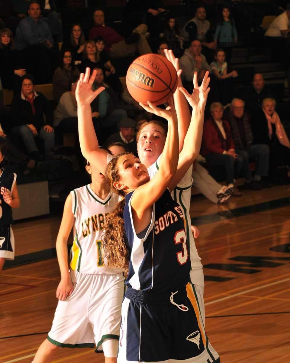 Lynbrook's #34 Jen Fay tries to block a
