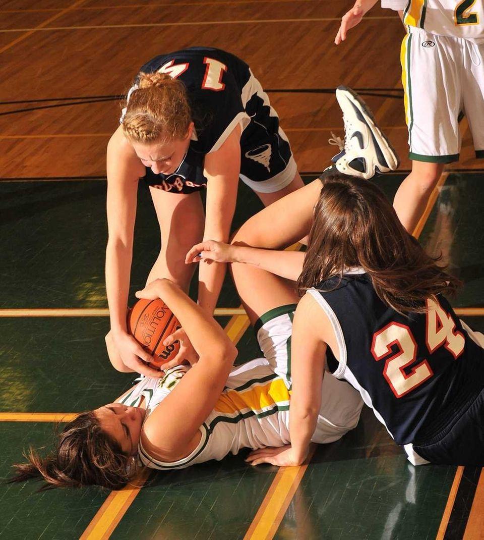 Lynbrook's #21 Danielle Amaya (bottom) battles #14 Megan