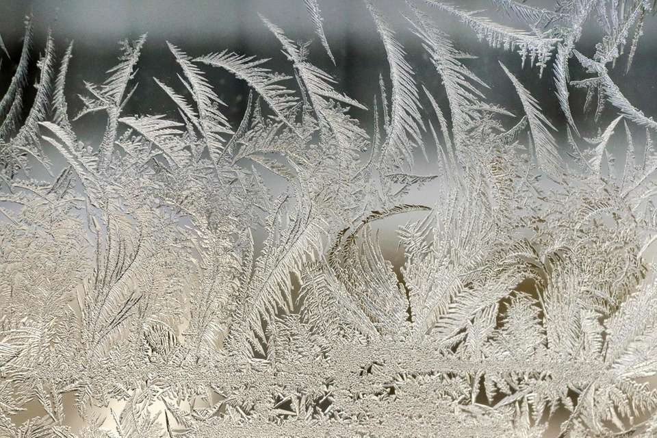Ice forms on the inside window of an