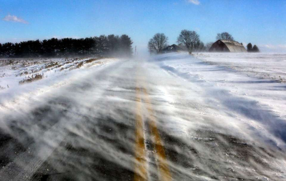 Drifting snow obscures a road near Mount Joy