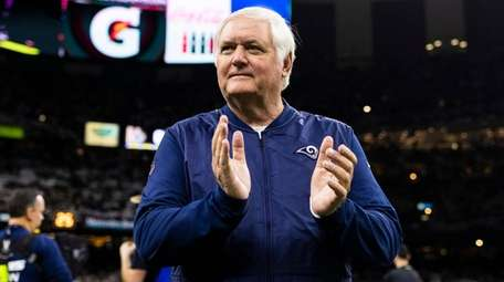 Rams defensive coordinator Wade Phillips claps during the
