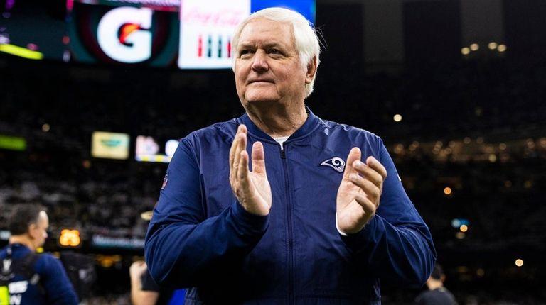 Rams defensive coordinator Wade Phillips claps during the
