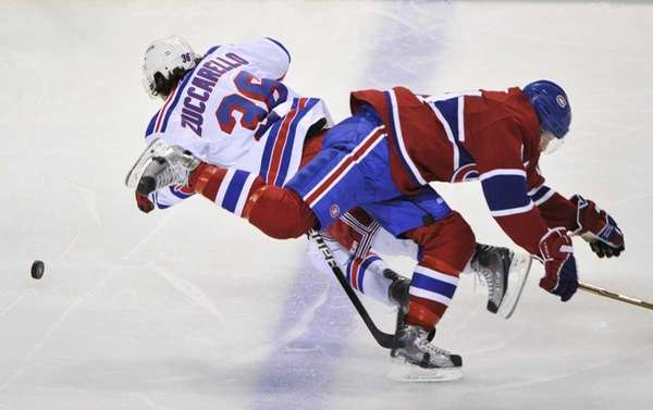 Montreal Canadiens' Tom Pyatt right, collides with New