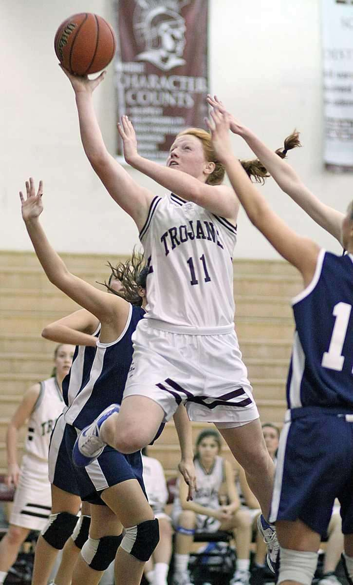 Barbara Sullivan gets to the hoop during the