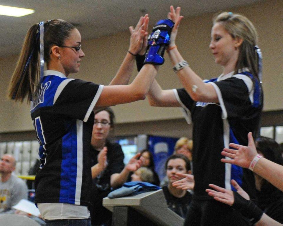 Division Avenue High School senior Erica Schneider, left,
