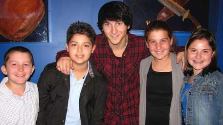 Actor and singer Mitchel Musso with Kidsday reporters