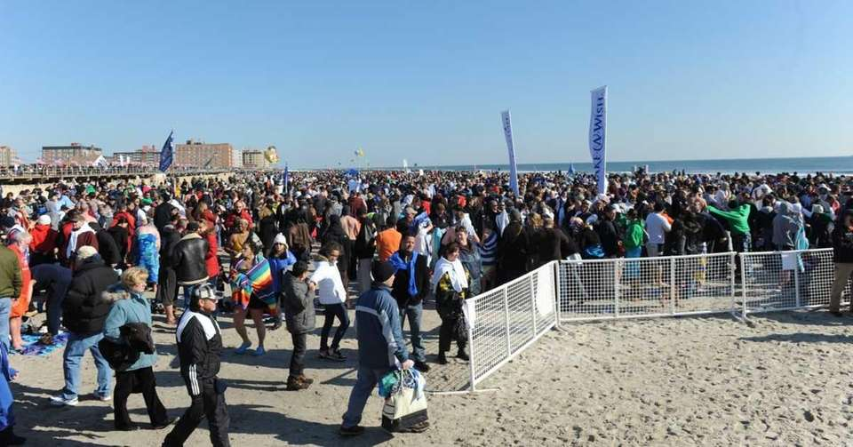 Thousands of revelers fill the beach at Riverside
