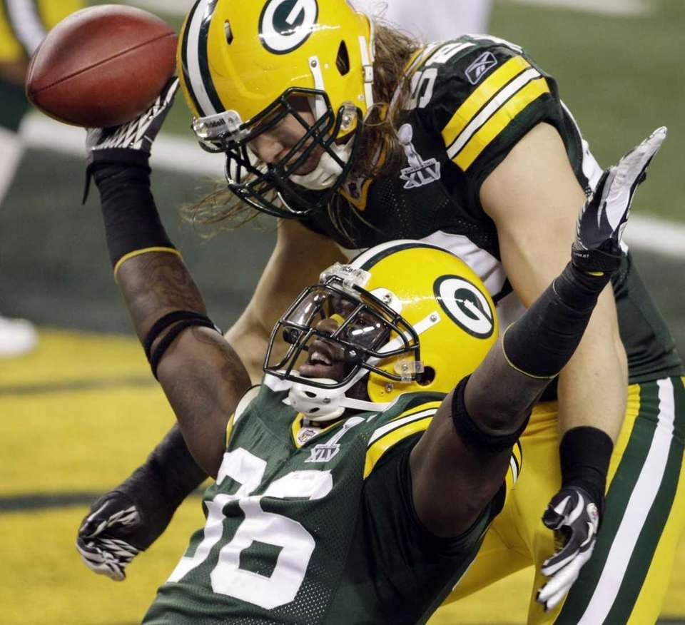 Green Bay Packers' Nick Collins (36) celebrates a