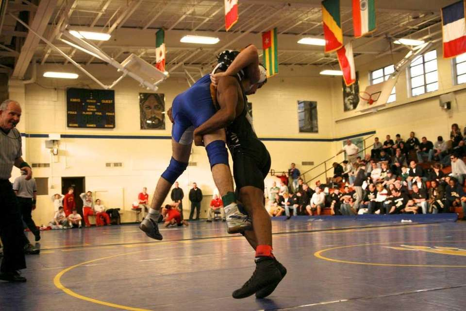 St. Anthony's Jamel Hudson wrestles James Corino of