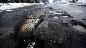 Potholes in the eastbound lanes of Route 25A