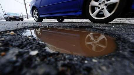 A pothole on New South Road in Hicksville