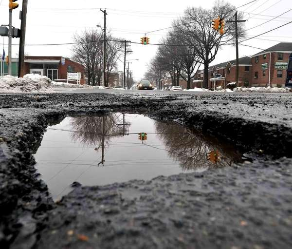 One of several huge potholes on Jackson Street