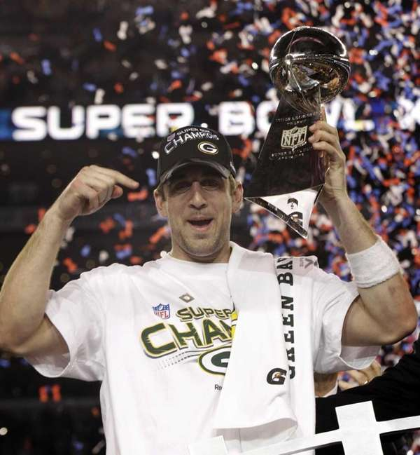 Green Bay's Aaron Rodgers holds the Vince Lombardi