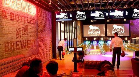 Guests bowling at the TAP Arcade & Bowling