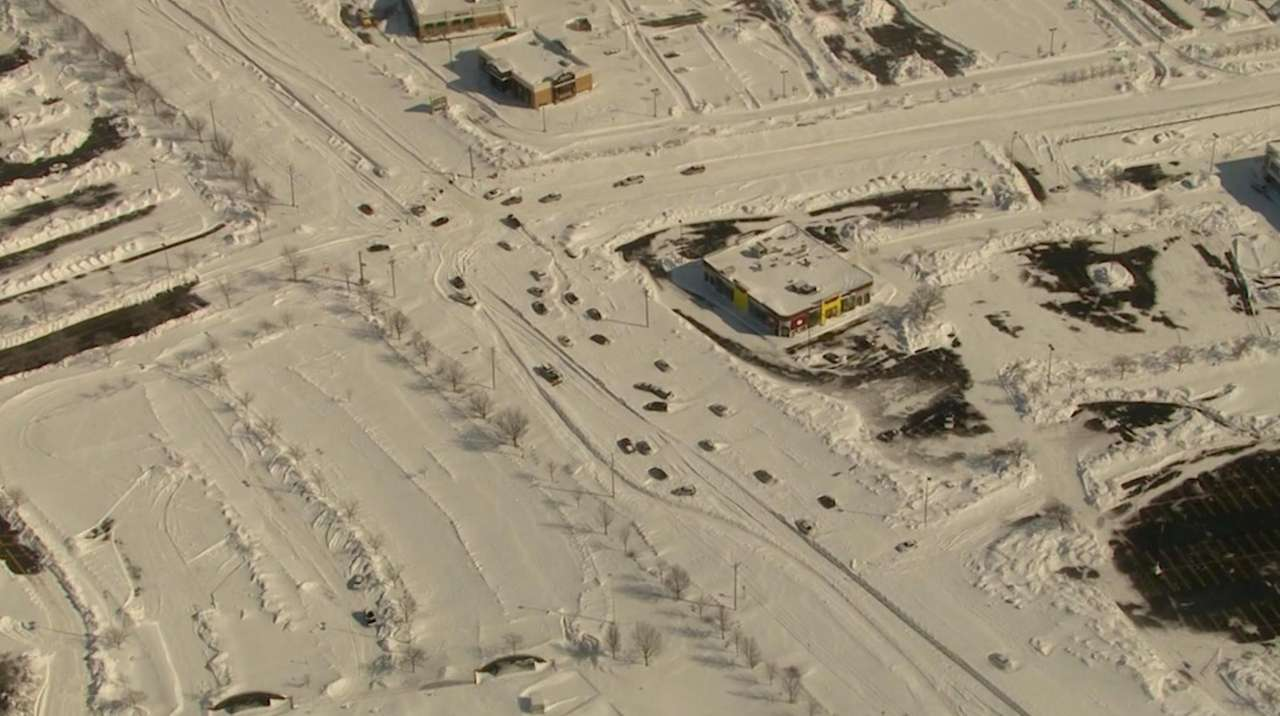 Vehicles are trapped on roads in Lake Grove