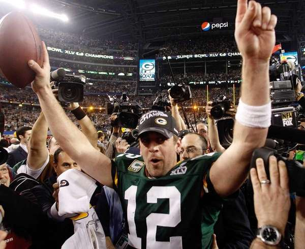 Green Bay Packers quarterback Aaron Rodgers celebrates at