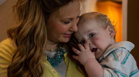 Sarah Dukes and her son in their Cedarhurst
