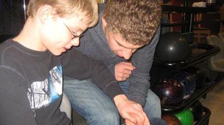 Patrick Donoghue, 12, and Isaac Vingan, 16, look