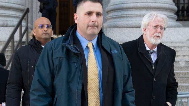 Former NYPD Lt. Paul Dean, center, exits a