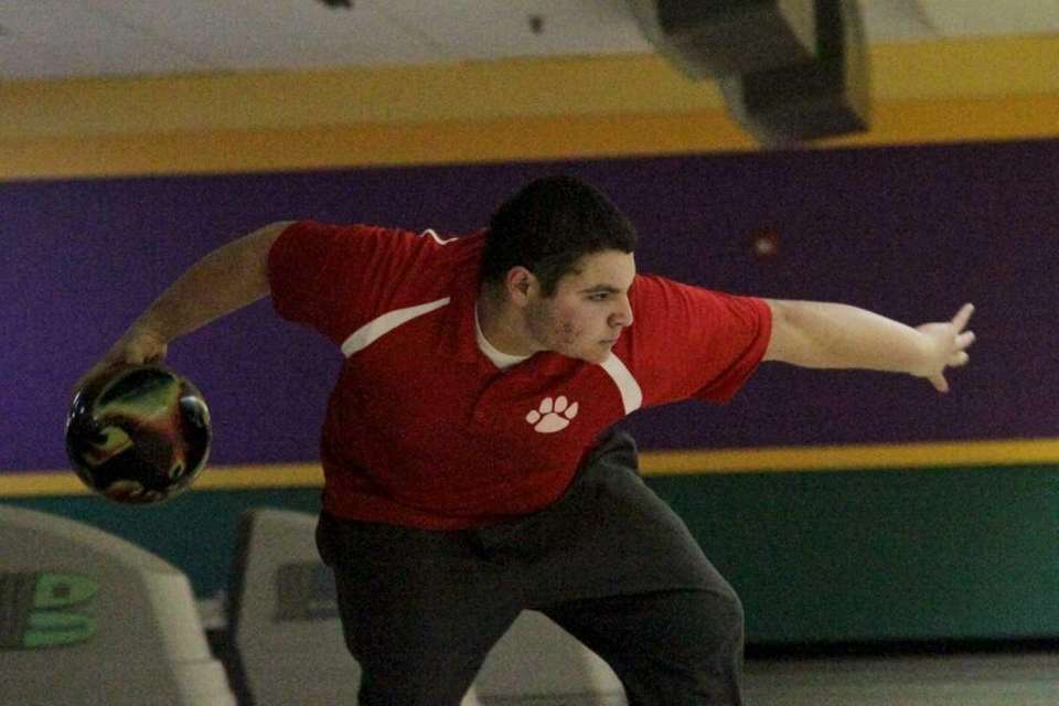 Justin Figueroa of St. John the Baptist competes