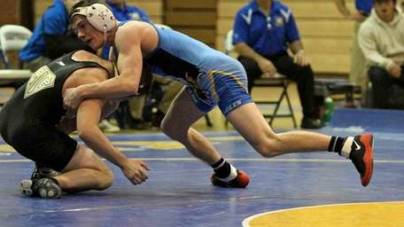 Hauppauge's Nick Mauriello, right, wrestles St. Anthony's in