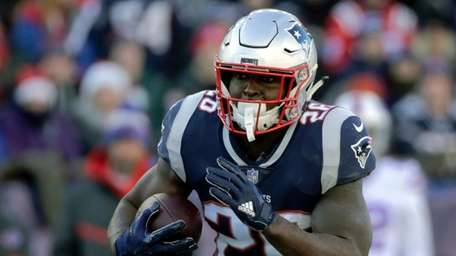 Patriots running back Sony Michel carries the ball