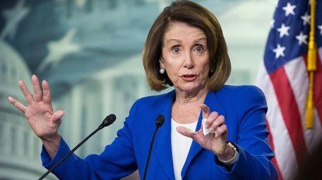 Speaker of the House Nancy Pelosi holds a