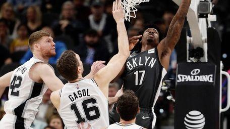 Nets forward Ed Davis shoots past San Antonio