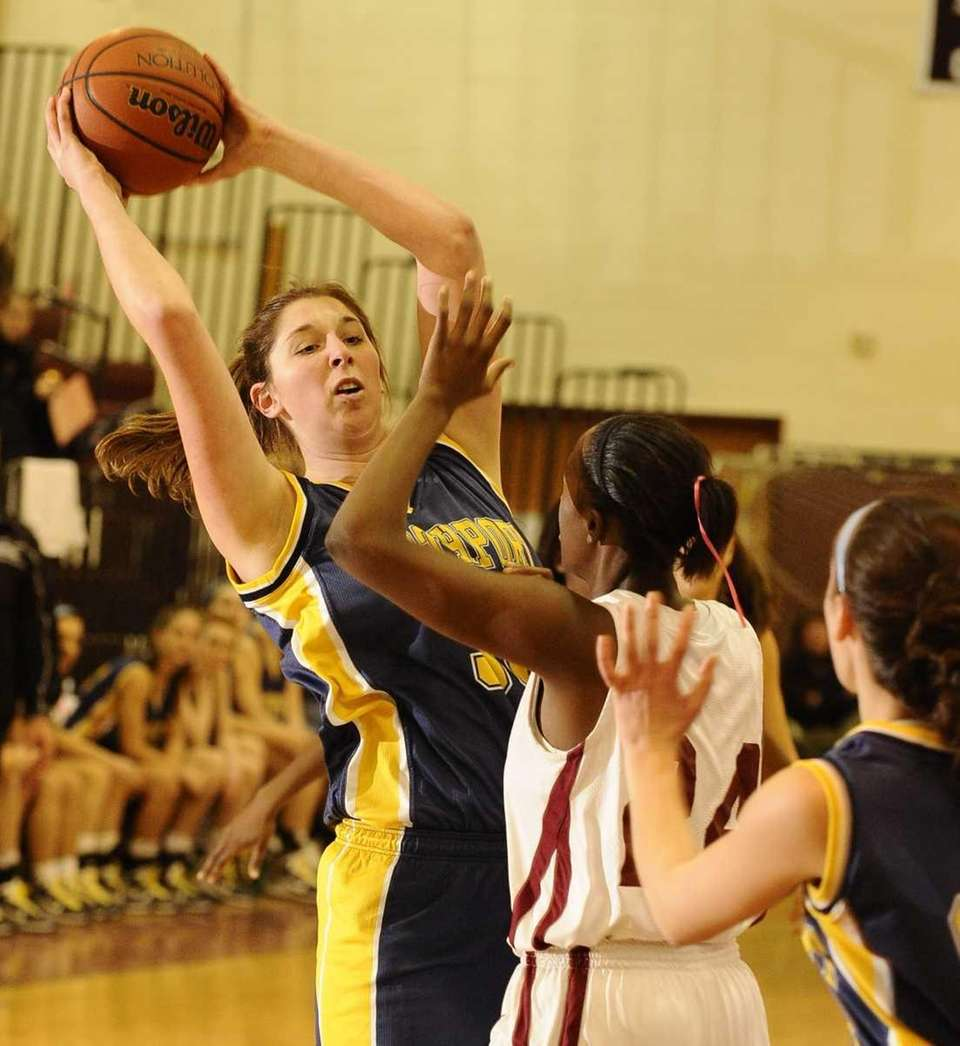 Northport's Stephanie Leon looks to shoot past Whitman's