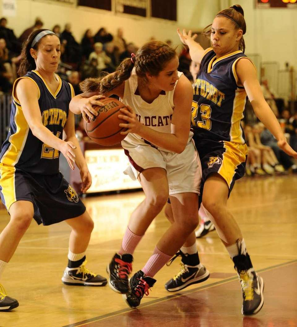 Whitman's Rachel Perea tries to drive past Northport's