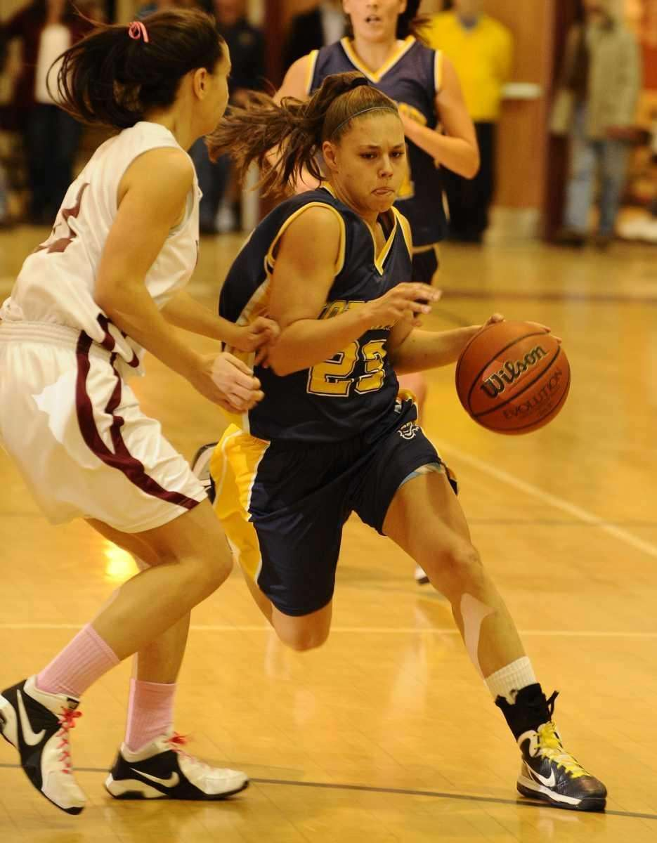 Northport's Chrystal Pope drives past a Whitman defender