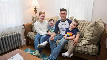 Alexis and Tim Heaney with their children, Ford,