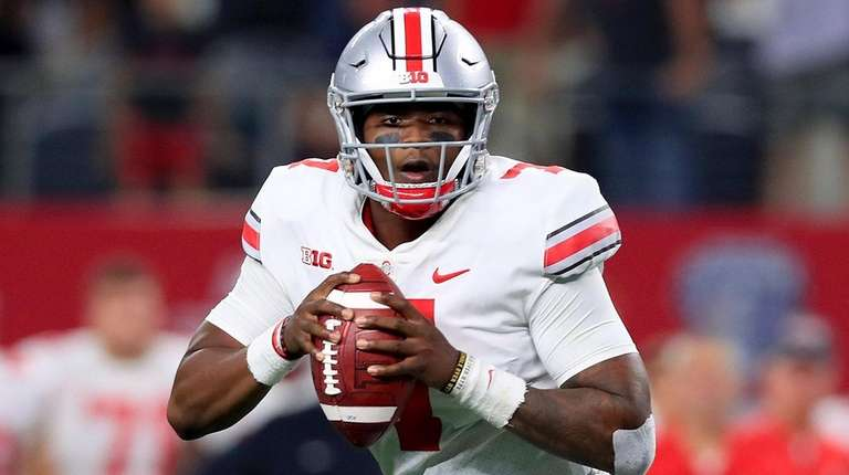 Dwayne Haskins of Ohio State looks for an